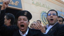 Egyptian police stage rare protest in defiance of new law