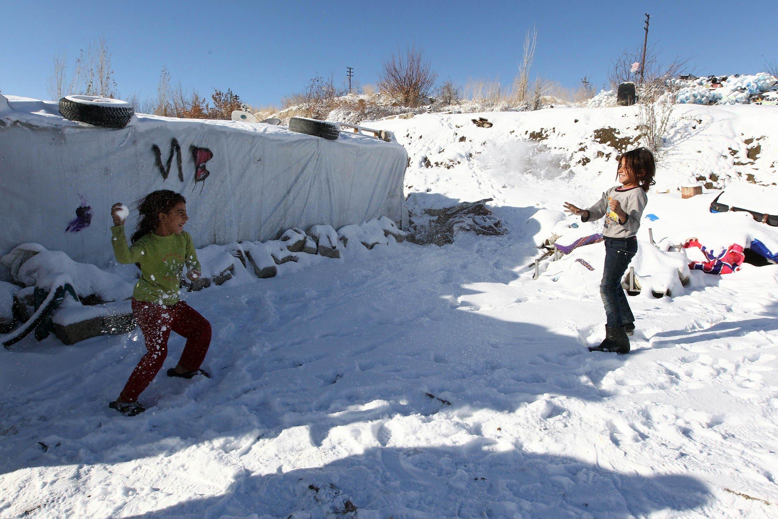 Syrian refugees smile despite heavy snowfall