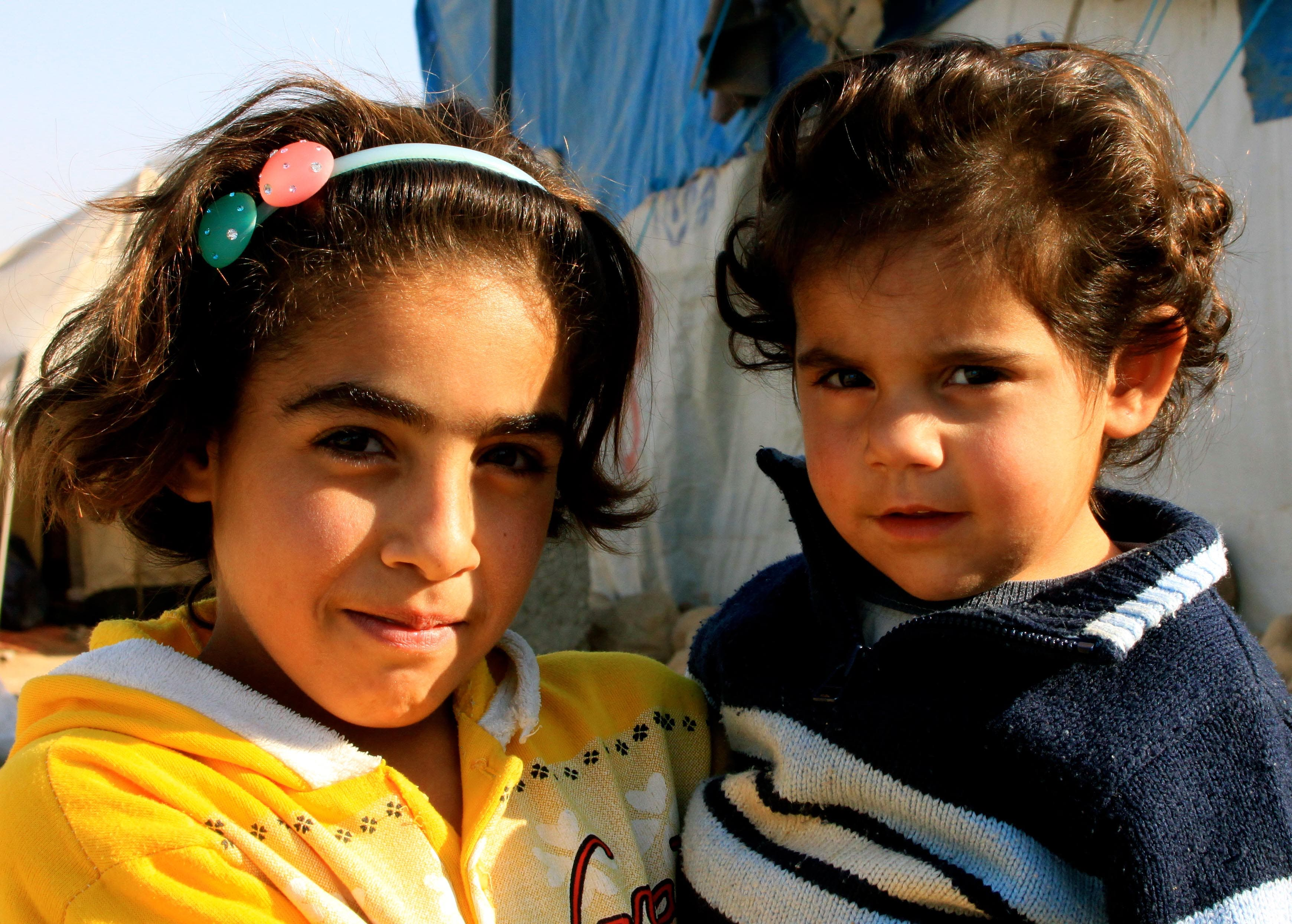 The Kurdish Syrian girl holds her sister. Around 80 per cent of refugees in the camp are from Damascus.