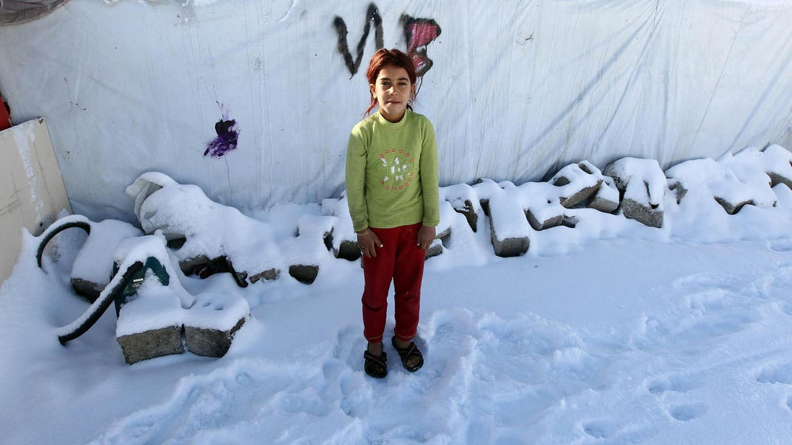 Syrian refugees smile despite heavy snowfall