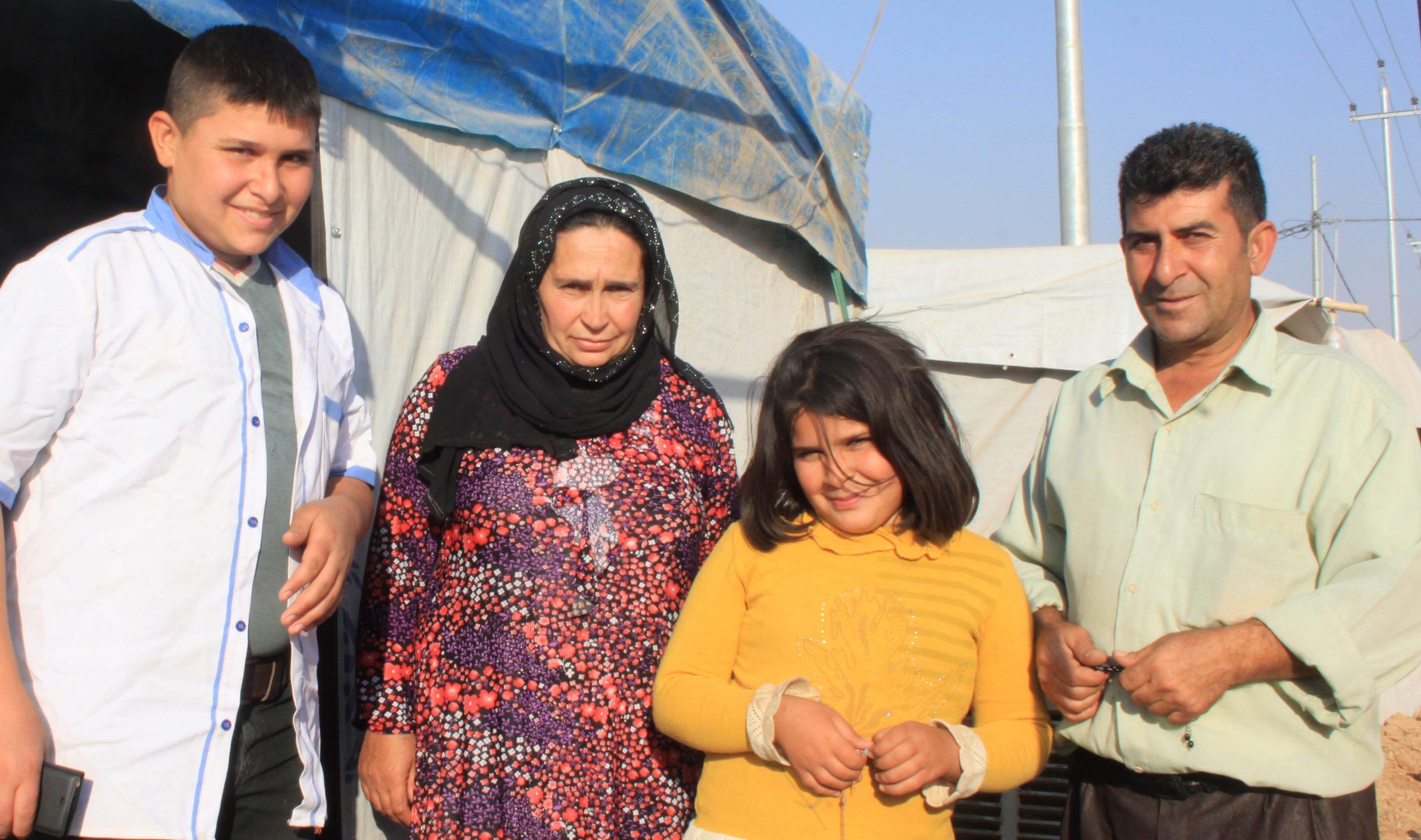 Qamarhan and family in their tent on the outskirts of Domiz.