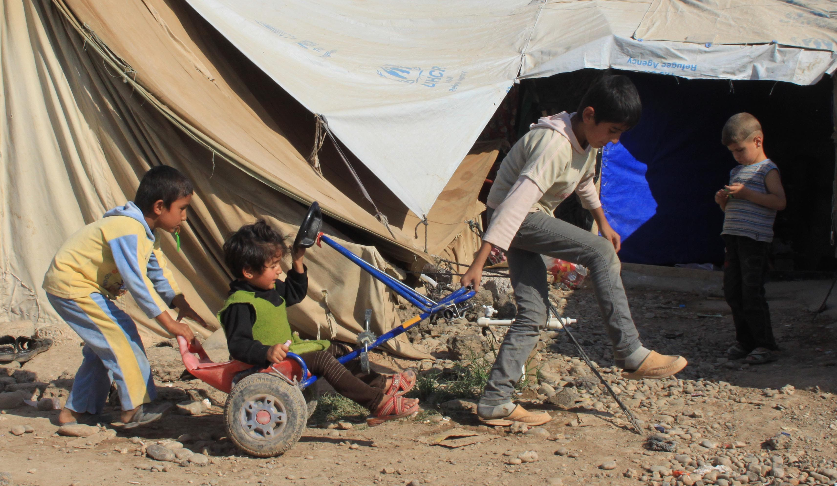 Kids playing at Domiz. The UN says over 60 percent of the Syrians in Iraqi Kurdistan's camps are children.