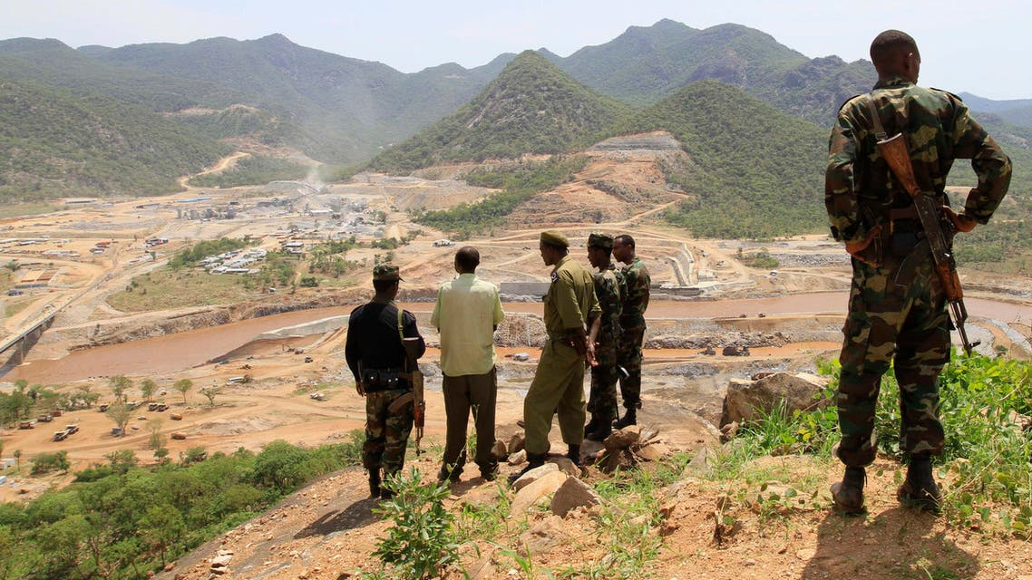 Security guards look at the construction of Ethiopia's Great Renaissance Dam in Guba Woreda, some 40 km (25 miles) from Ethiopia's border with Sudan, June 28, 2013. reu