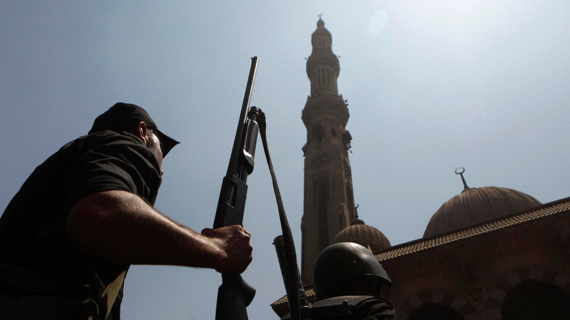 Armed Egyptian policeman moves into position in front of al-Fath mosque on Ramses Square in Cairo August 17, 2013. reuters