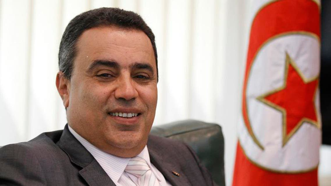 Tunisia's Industry Minister Mehdi smiles in his office in Tunis in this June 25, 2013 file photo. (Reuters)