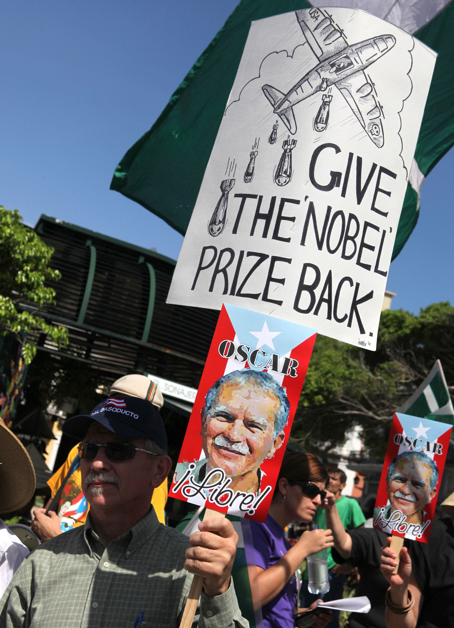 A man holds a placard during a protest against the visit of U.S. President Barack Obama to Puerto Rico in June, 2011. (File photo: Reuters)
