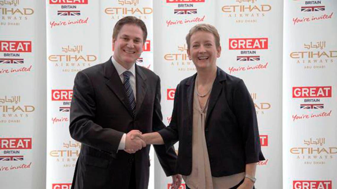 Peter Baumgartner, chief commercial officer at Etihad, and Sandie Dawe, chief executive of VisitBritain, signed a memorandum of understanding in Abu Dhabi. (Image courtesy: VisitBritain)