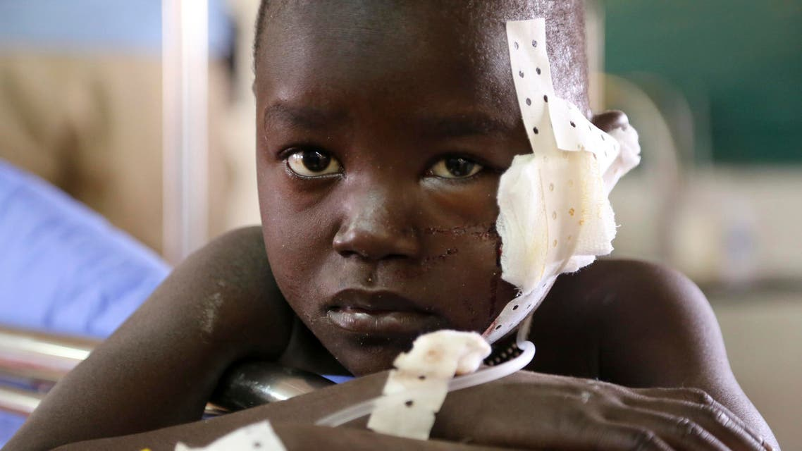 A young boy, injured while fleeing from clashes, rests at a medical clinic inside the United Nations compound on the outskirts of the capital Juba in South Sudan, December 17, 2013. reuters