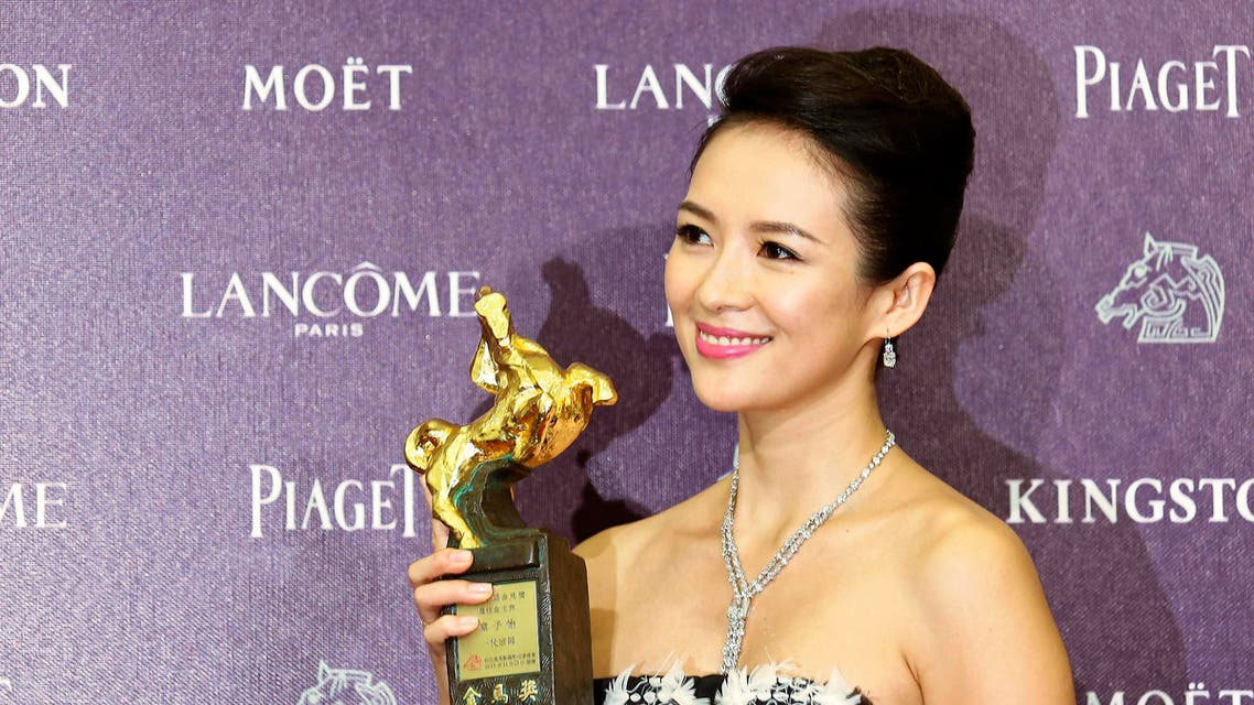 "Chinese actress Zhang Ziyi celebrates winning the Best Leading Actress for ""The Grandmaster"" at the 50th Golden Horse Film Awards in Taipei November 23, 2013. reuters"