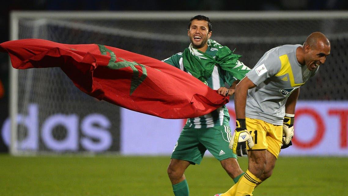Morocco Raja Casablanca's goalkeeper Khalid Askri (L) celebrates after winning the semi-final football match against Brazil's Atletico Mineiro