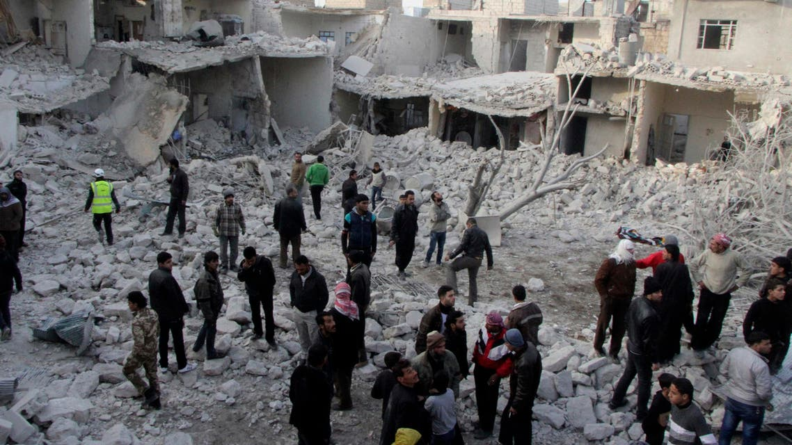 Residents search for survivors at a damaged site after what activists said was an air strike from forces loyal to Syria's President Bashar al-Assad in Tareek Al-Bab area of Aleppo, December 18, 2013.
