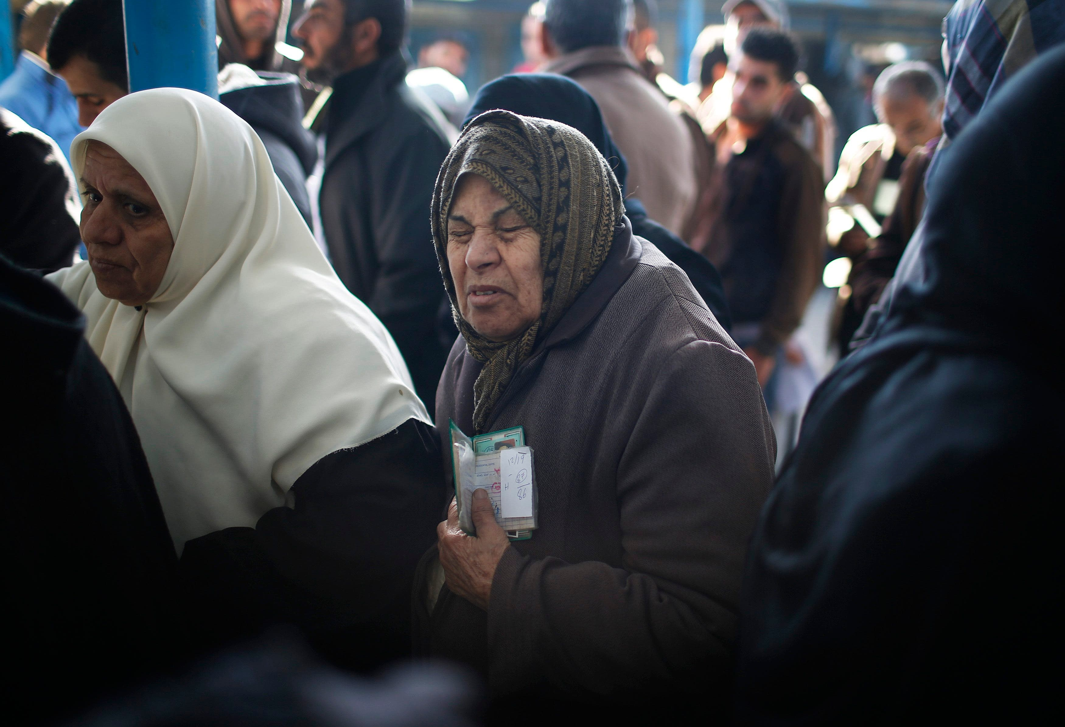 Palestinians receive food aid from U.N. distribution center
