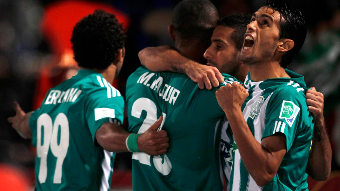 Raja Casablanca's Mouhssine Iajour (2nd L) celebrates his goal against Atletico Mineiro with his teammates during their FIFA Club World Cup semi-final soccer match at Marrakech stadium, Dec. 18, 2013. (Reuters)