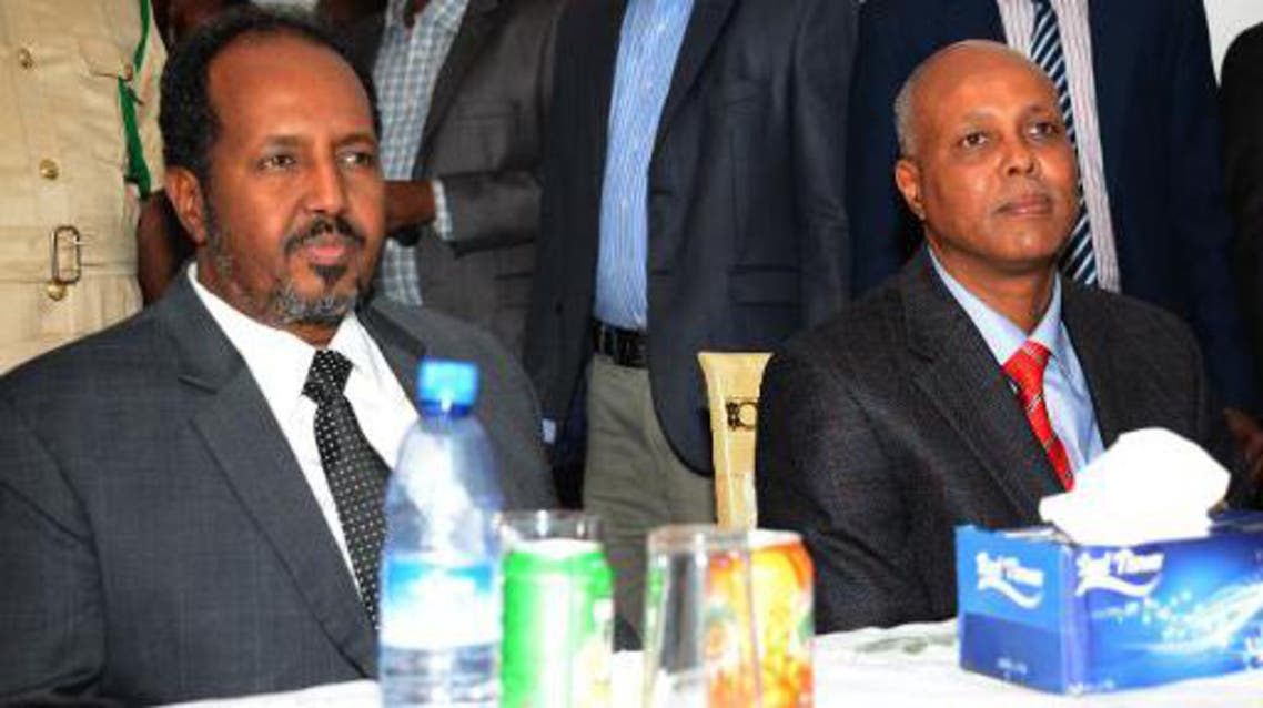 Somalia's newly appointed Prime Minister, Abdiweli Sheikh Ahmed (right) sits next to President Hassan Sheikh Mohamud on December 12, 2013 in Mogadishu (AFP