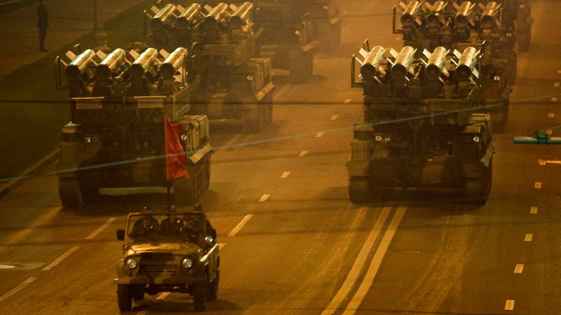 Armoured vehicles are driven past the walls of the Kremlin during a night training exercise for the V-day military parade in Moscow April 29, 2008.