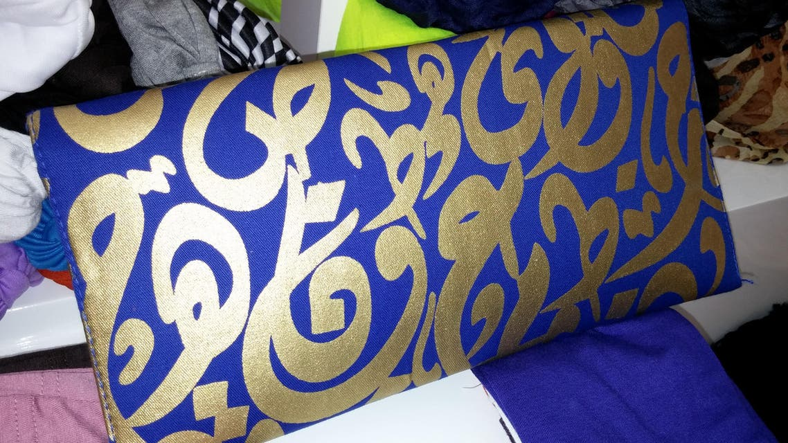 Arabic letters inscribed on shirts, scarves and handbags are seen by many a way to reflect Arab culture. (Al Arabiya)