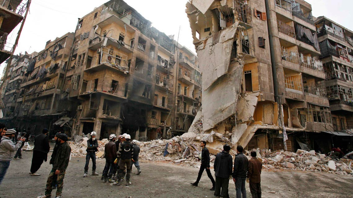 A general view showing damages after what activists said was an airstrike with explosive barrels from forces loyal to President Bashar al-Assad in Al-Shaar area in Aleppo December 17, 2013.