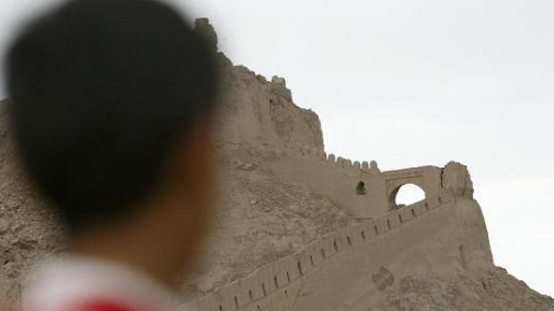 An boy looks at the Bam citadel on June 11, 2005, in Bam, Iran
