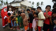 Christmas in mud as rain pelts Philippine disaster zone