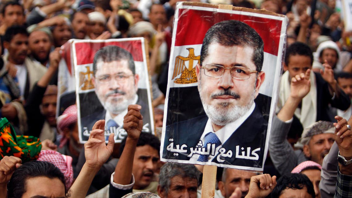 Supporters of Egypt's deposed Islamist President Mohamed Mursi shout slogans during a rally in protest against the recent violence in Egypt, in Sanaa