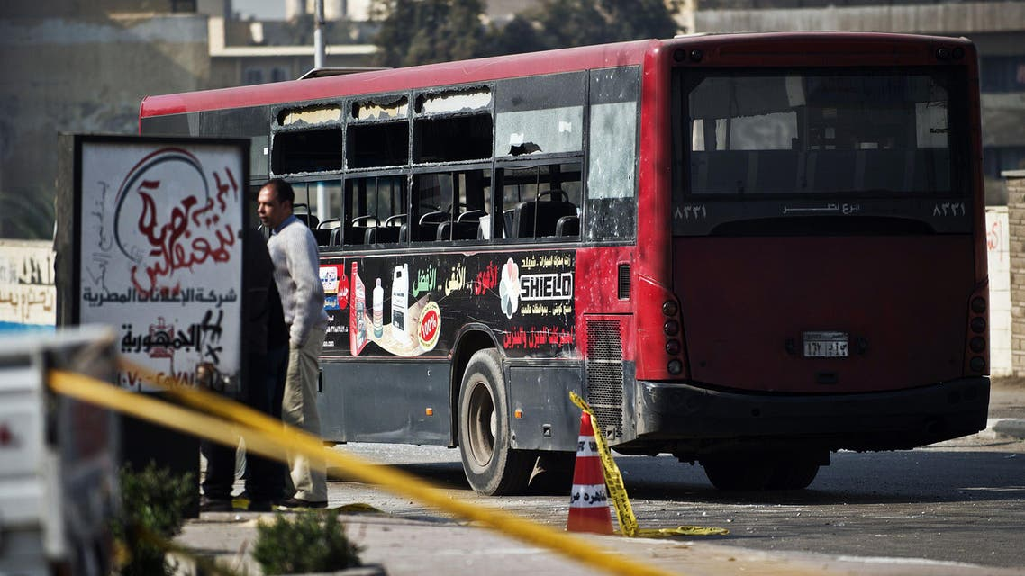Egyptian security officials inspect the wreckage of a bus that was damaged by an explosion on December 26, 2013 in Cairo. Reuters
