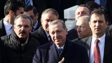 Battered Erdogan seen weathering storm as scandal deepens