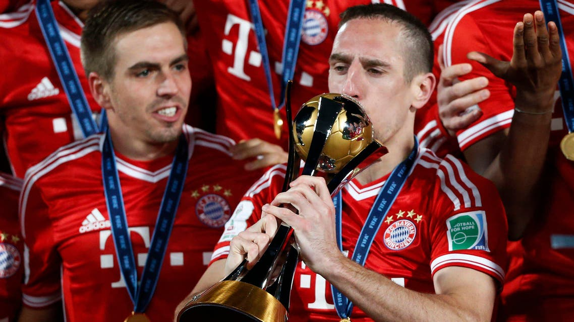 Germany's Bayern Munich Franck Ribery kisses the trophy as he celebrates with his team mates after winning their 2013 FIFA Club World Cup final soccer match against Morocco's Raja Casablanca at Marrakech stadium Dec. 21, 2013. (Reuters)