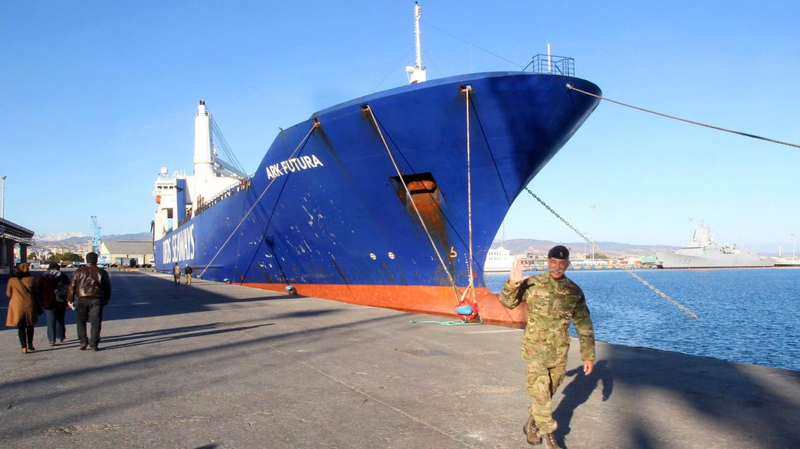 One of two cargo ships intended to take part in a Danish-Norwegian mission to transport chemical agents out of Syria docks in Limassol, December 14, 2013.
