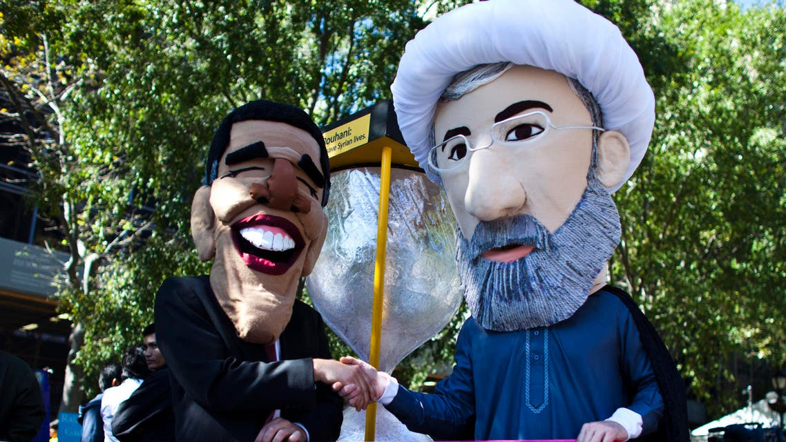 Members of international advocacy group Avaaz take part in a protest wearing masks of Iran's new President Hassan Rowhani (R) and U.S. president Barack Obama, outside the U.N. headquarters in New York Sep. 24, 2013. (File photo: Reuters)
