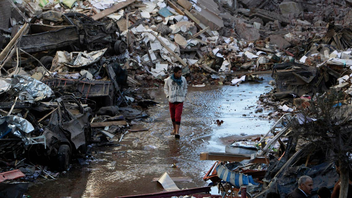A boy walks past debris at the site of an explosion at the Building of the Directorate of Security in Egypt's Nile Delta town of Dakahlyia, about 120 km (75 miles) northeast of Cairo December 24, 2013.