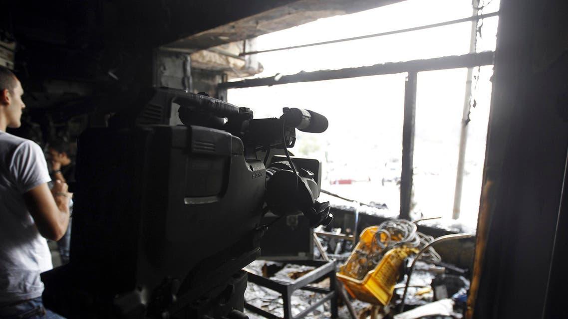 People are seen in a burnt studio of Al Jazeera TV network, at Tahrir Square in Cairo Nov. 21, 2012. (File photo: Reuters)
