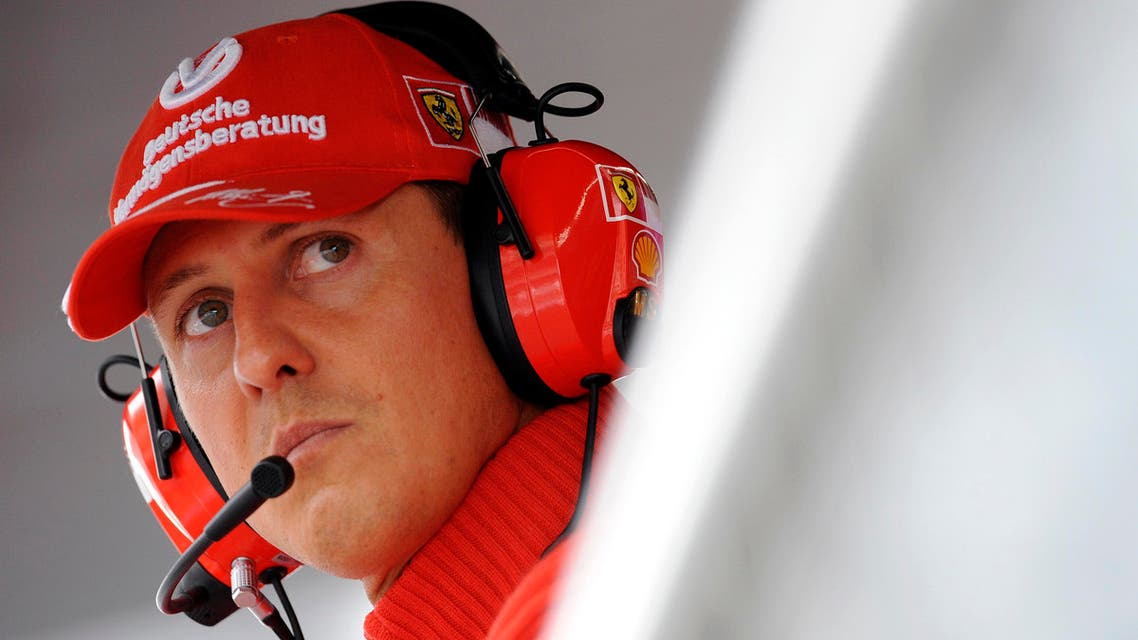 Former Ferrari driver Michael Schumacher of Germany looks on during the qualifying session for the Italian F1 Grand Prix race at the Monza racetrack in Monza, near Milan, in this September 13, 2008 file photo.