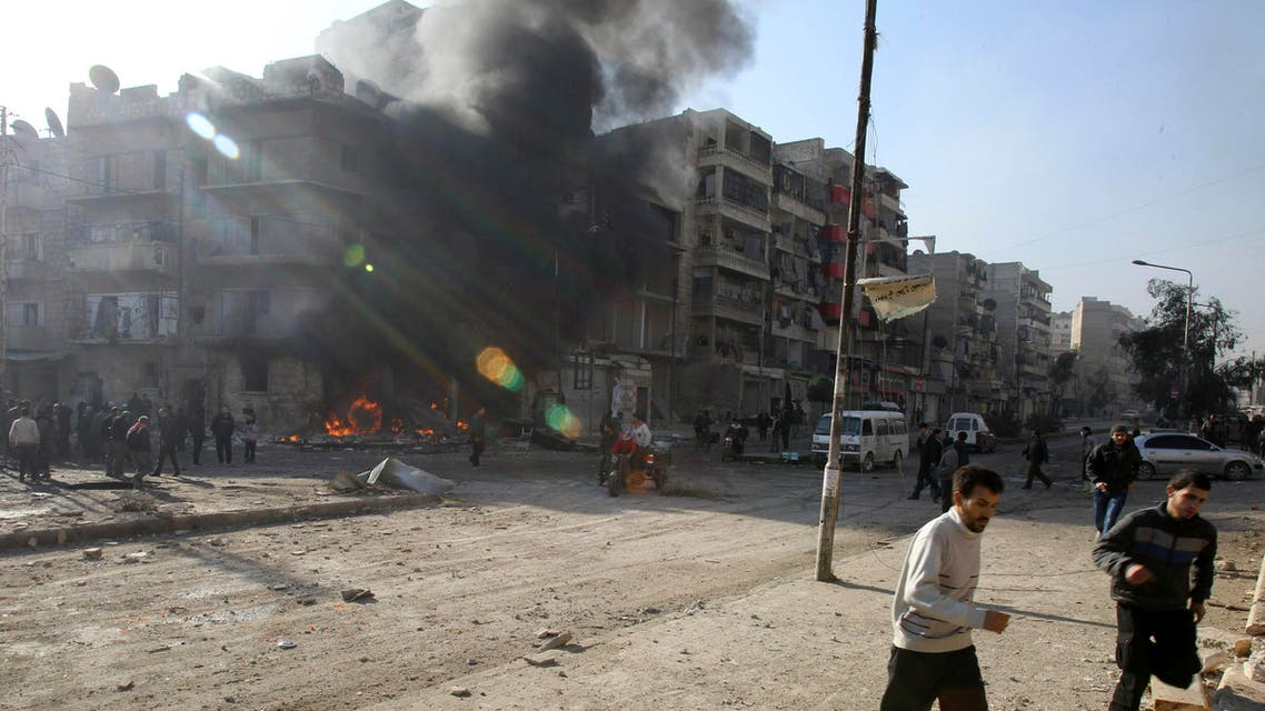 People run after an air raid in Aleppo on Dec. 24, 2013. The Committee to Protect Journalists says 29 journalists have died covering the civil war in Syria. (File photo: Reuters)
