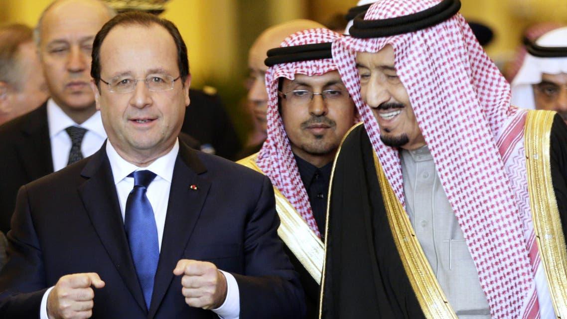 Saudi Arabia's Crown Prince Salman bin Abdul Aziz al-Saud (R) walks alongside French President Francois Hollande (L) following a meeting with Saudi businessmen in Riyadh on Dec. 30, 2013. (AFP)