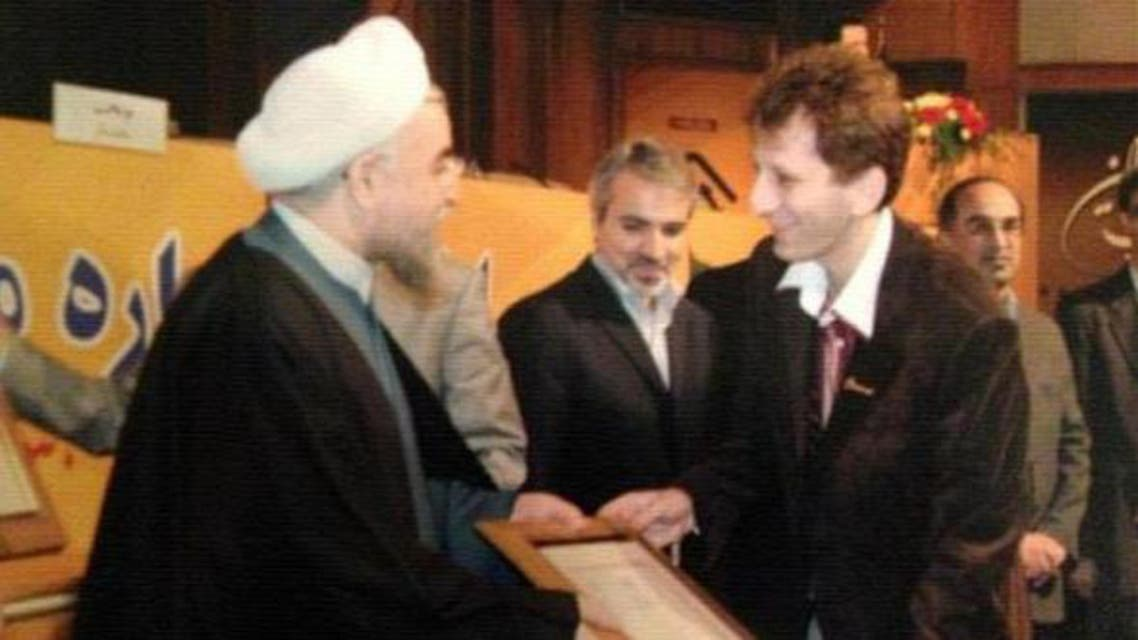 بابك زنجاني والرئيس الإيراني حسن روحاني
