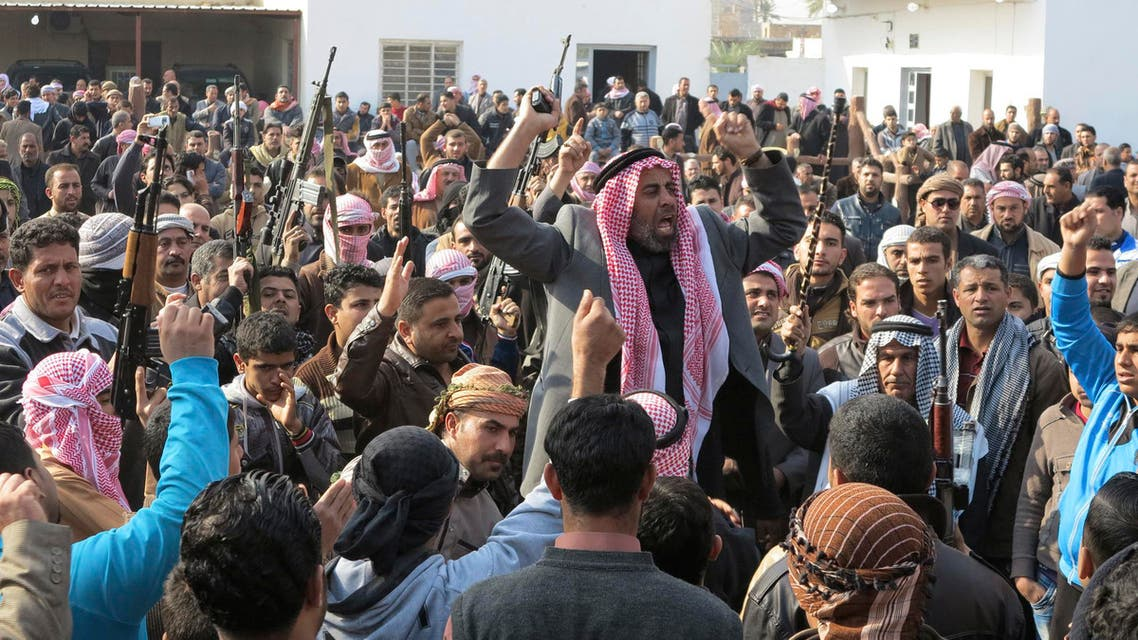 Residents gather to protest near the house of prominent Sunni Muslim lawmaker Ahmed al-Alwani, in the centre of Ramadi, December 29, 2013