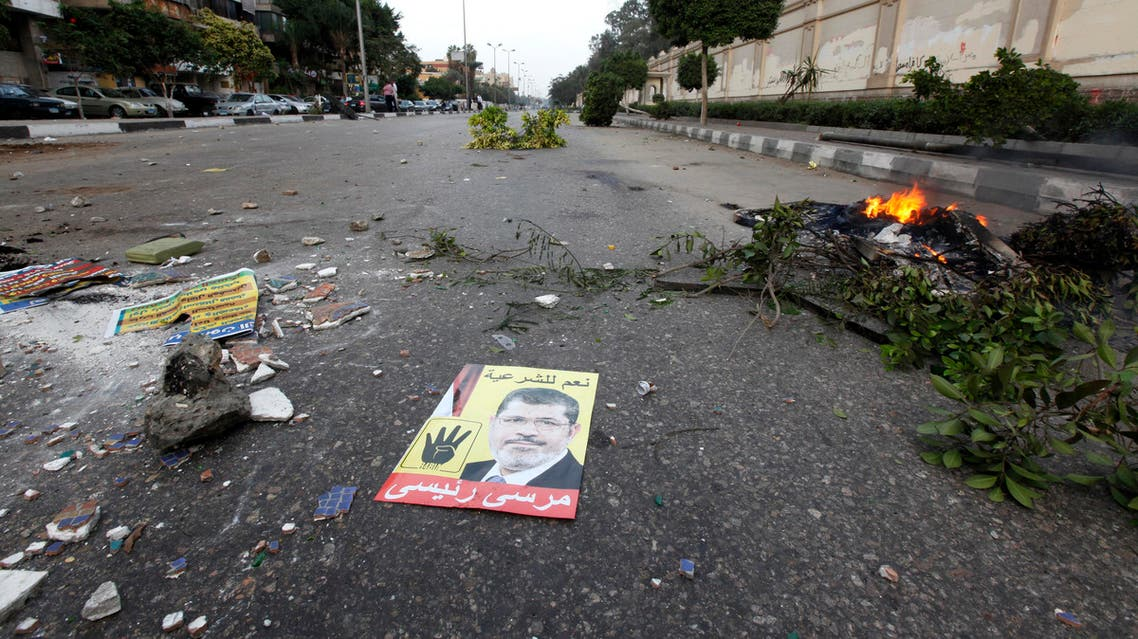 A poster of ousted Egyptian President Mohamed Mursi is seen on ground during clashes between supporters of the Muslim Brotherhood and riot police in Cairo last month. (Reuters)