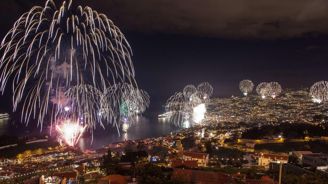 Fireworks light up the sky above Funchal Bay, Madeira Island, to celebrate the arrival of the New Year on January 1, 2013.  World cities from Sydney to Dubai rang in the  New Year with a spectacular global wave of firework displays. (AFP)