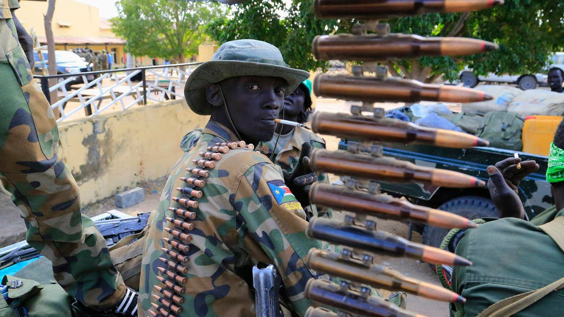 A South Sudan army soldier stands next to a machine gun mounted on a truck in Malakal town, 497km (308 miles) northeast of capital Juba reuters