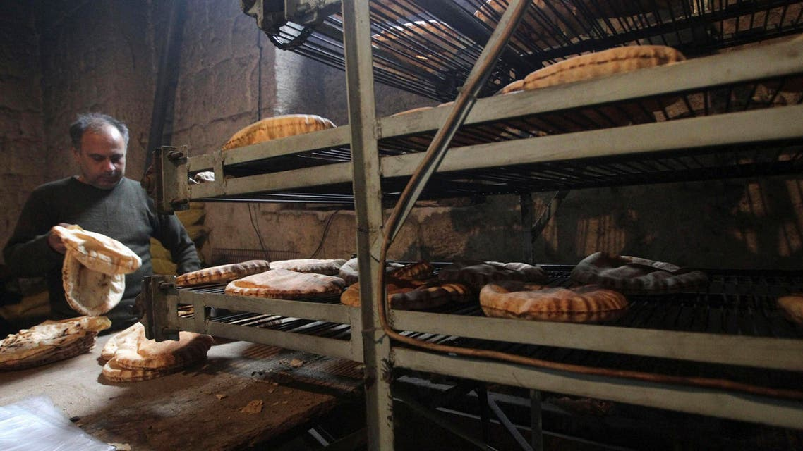 A man works at a bakery in Aleppo city December 30, 2013. (Reuters)