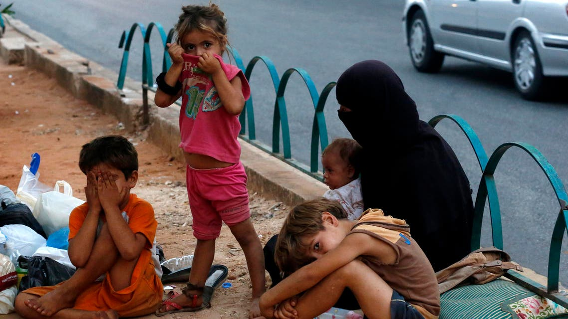Homeless Syrian children are seen along a street in Beirut July 22, 2013. (Reuters)