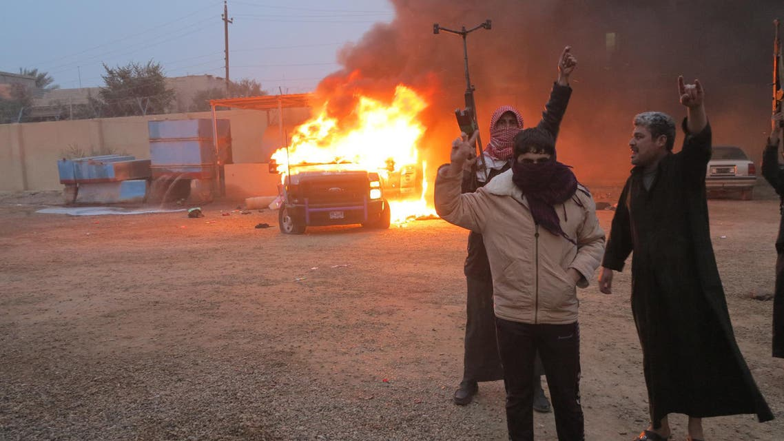 Protesters burn a police vehicle during fighting in Ramadi Dec. 31, 2013. Fighting erupted when Iraqi police broke up a Sunni Muslim protest camp in the western Anbar province on Monday, leaving at least 13 people dead, police and medical sources said. (Reuters)
