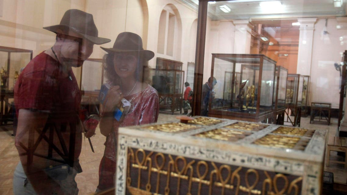Tourists look at Egyptian artifacts at the Egyptian Museum in cairo. reuters