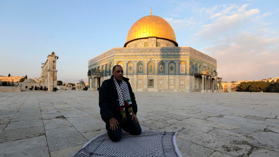 Ahmad Khalaf prays outside al-Aqsa mosque after he was released from an Israeli prison, in Jerusalem's old city December 31, 2013. reuters