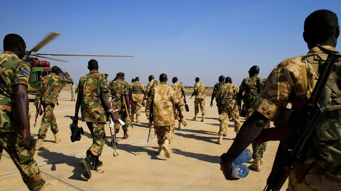 South Sudan army soldiers walk to board a military helicopter at Juba international airport, before heading to Bor, 180km (108 miles) northwest from the capital December 25, 2013. reuters