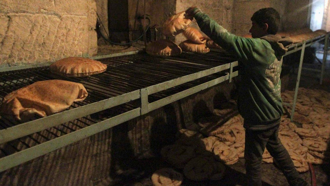 A boy works in a bakery in Aleppo city Dec. 30, 2013. (Reuters)