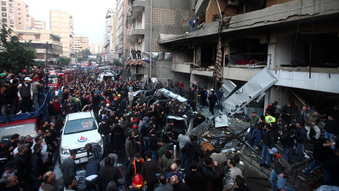 People gather at the site of an explosion in Beirut's southern suburbs, Jan. 2, 2014. (Reuters)