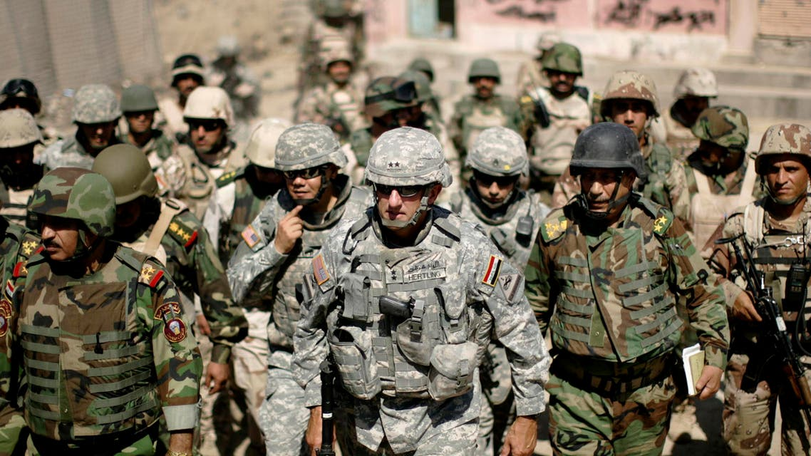 Major-General Mark Hertling (C), the commander of the U.S. forces in northern Iraq, walks during a battlefield circulation patrol on the streets in Mosul June 19, 2008.