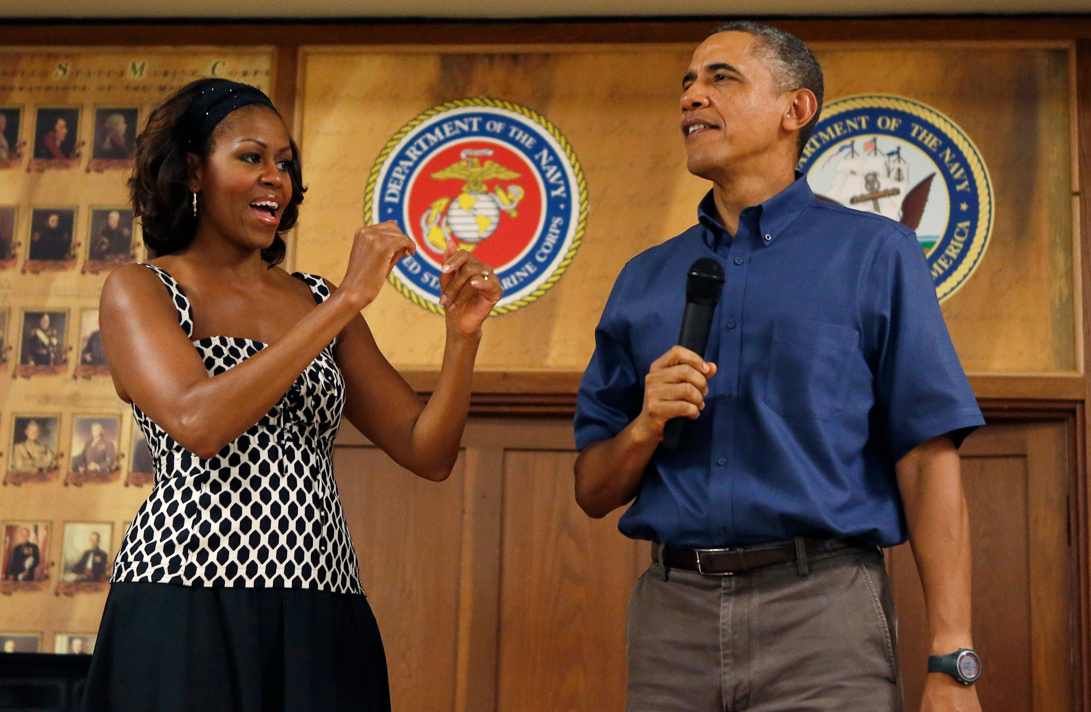 U.S. President Barack Obama and first lady Michelle Obama address military personnel during a Christmas day visit to Marine Corps Base Hawaii in Kaneohe, Hawaii December 25, 2013. reuters