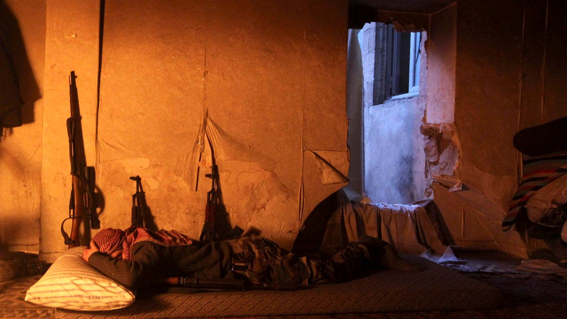 A Free Syrian Army fighter rests in a safehouse on a frontline in Old Aleppo January 5, 2014.